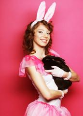 happy woman with black rabbit