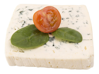 blue cheese decorated with arugula and sliced cherry tomato isol