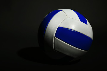 Volleyball ball on black background