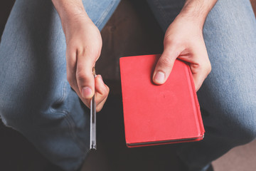 Man with pen and notebook