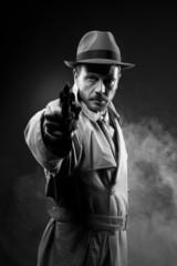 Vintage agent pointing a gun