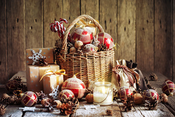 Christmas Basket with Vintage Gifts and Candle. Toned effect