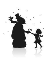 Mädchen verschenkt Herz an Schneemann