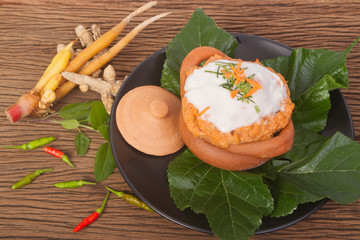 steamed fish with curry paste in clay pot