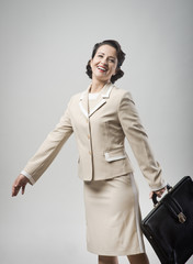 Cheerful vintage woman walking with briefcase