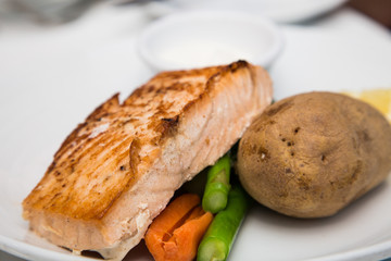 Baked Salmon Fillet with Vegetables and Baked Potato