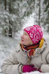 Portrait of a middle-aged woman in winter in the forest
