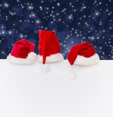 weihnachtsmützen in der nacht freiraum
