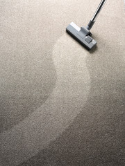 Vacuum cleaner on a carpet with a extra clean strip