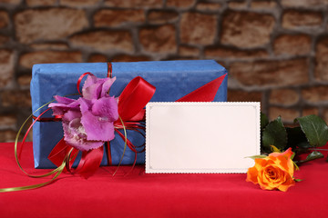Postcard with gift with rose