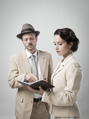 Vintage manager and secretary working together