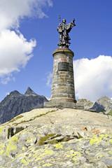 Statue of Saint Bernard, mountain Great St. Bernard Pass, Alps
