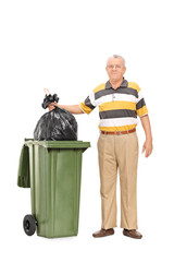 Senior throwing out the trash