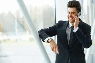 Smiling Business Man Talking on Mobile Phone