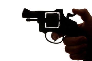 man shooting a handgun