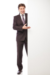 Man leaning against empty board isolated