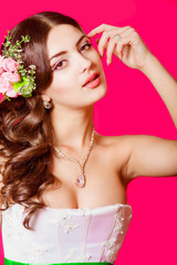 Young beautiful bride in a white dress with a bouquet