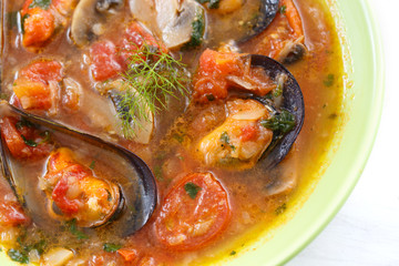top view of mussels soup with vegetables