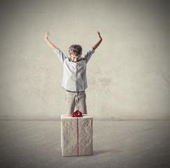 Happy boy receiving a big gift