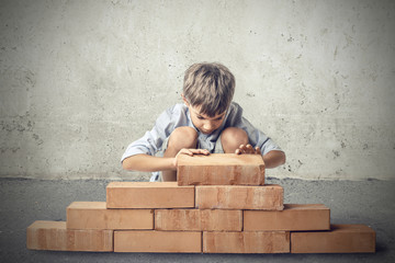 Little boy building a house