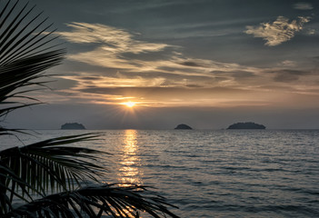 Sunset on the beach of Siam Bay, Thailand