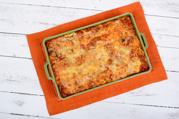 lasagna in a green dish