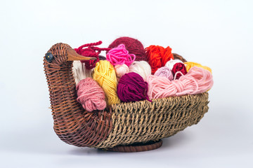 multi-colored balls of yarn in a wicker basket - duck