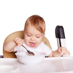 Baby eating. Healthy food concept.