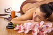 Masseur doing massage on woman body in the spa salon