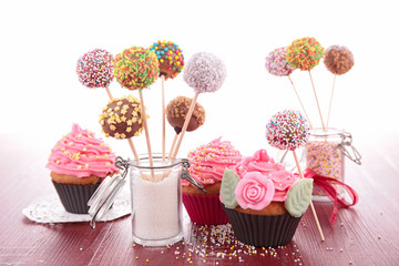 colorful cake pops and cupcake