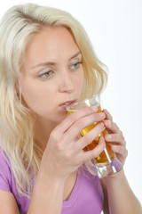 Attractive woman drinking a beer