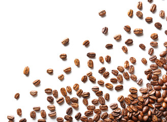 Coffee beans on white table, close-up