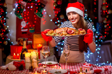 Woman preparing for Christmas dinner