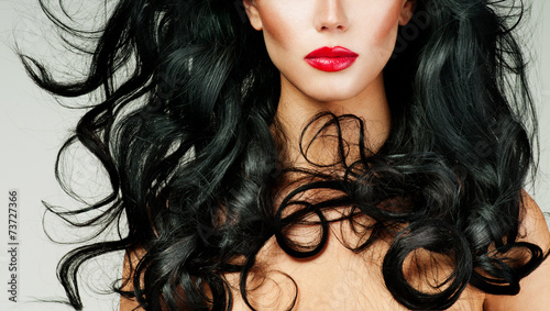 canvas print picture brunette with long hair and red lipstick