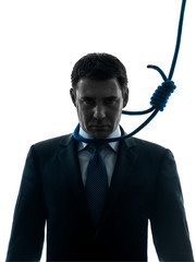 business man with hangman noose around the neck silhouette