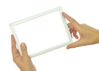 Hands holding blank photo frame isolated on white background