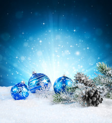 magic of christmas - blue balls on snow.
