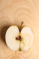 Half apple on wooden background