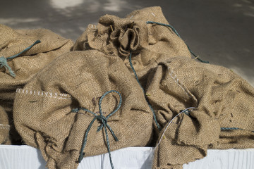 Multiple sack bags with strings tied at the opening