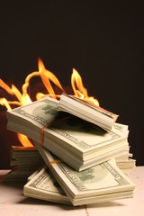 Crisis. One hundred dollars in fire, burning dollar, ashes