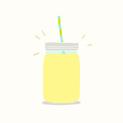 Yellow smoothie in a jar.