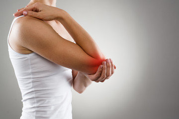 Woman suffering from chronic joint rheumatism