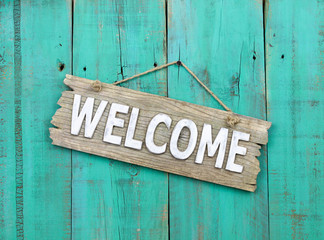 Wood welcome sign with antique teal blue background