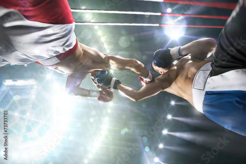 Deurstickers Vechtsport Two professionl boxers are fighting on arena