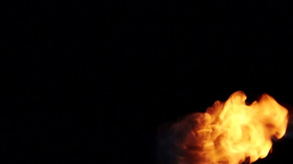 real flames isolated on black background
