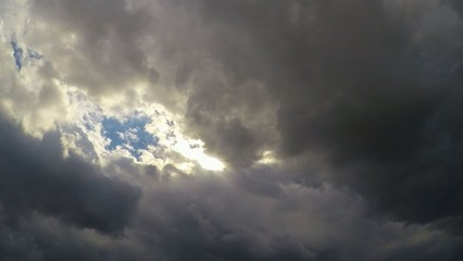 Time lapse Rain clouds forming over blue sky