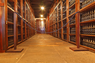 The shelves are made with wine bottles
