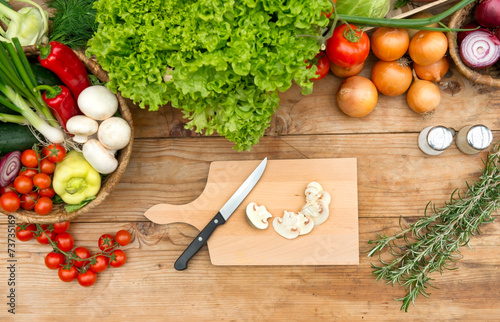 canvas print picture Cutting board with mushrooms