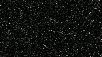 snow falling - lots of 3d snowflakes on black, 30fps loop