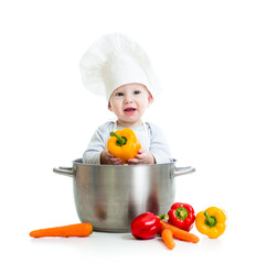cook baby inside big pan with healthy food